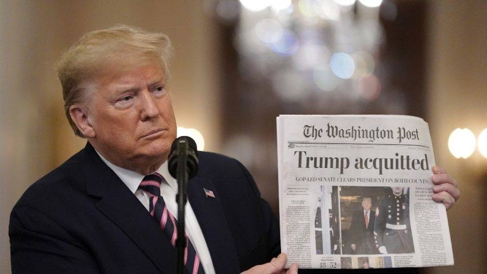 WASHINGTON, DC - FEBRUARY 06: U.S. President Donald Trump holds a copy of The Washington Post as he speaks in the East Room of the White House one day after the U.S. Senate acquitted on two articles of impeachment, ion February 6, 2020 in Washington, DC. After five months of congressional hearings and investigations about President Trumps dealings with Ukraine, the U.S. Senate formally acquitted the president on Wednesday of charges that he abused his power and obstructed Congress. Drew Angerer/Getty Images/AFP